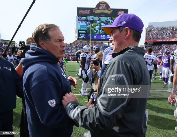 Head coach Bill Belichick of the New England Patriots and head coach Mike Zimmer of the Minnesota Vikings greet on the field after the end of the...