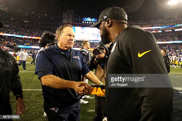 Head coach Bill Belichick of the New England Patriots and head coach Mike Tomlin of the Pittsburgh Steelers shake hands after the Patriots defeated...