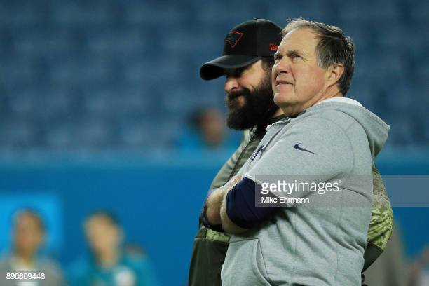 Head coach Bill Belichick of the New England Patriots and offensive coordinator Matt Patricia talk prior to their game against the Miami Dolphins at...