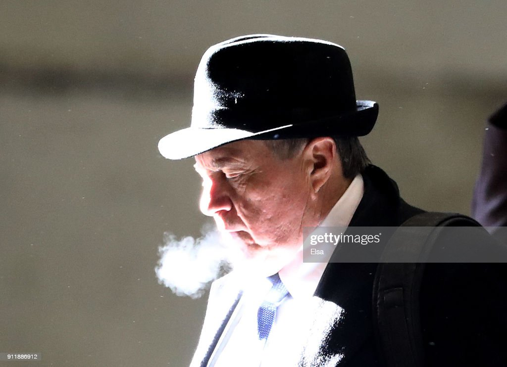 Head coach Bill Belichick of the New England Patriots arrives with his teammates for Super Bowl LII on January 29, 2018 at the Minneapolis-St. Paul International Airport in Minneapolis, Minnesota.