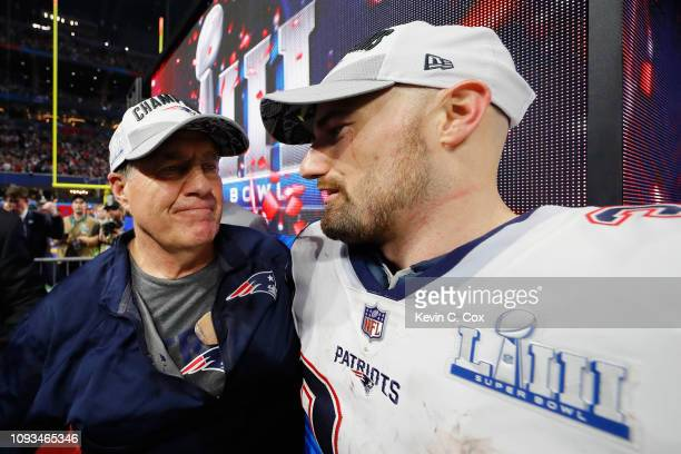 Head Coach Bill Belichick of the New England Patriots celebrates with his player Rex Burkhead after winning the Super Bowl LIII against the Los...
