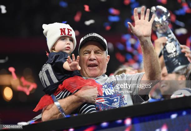 Head Coach Bill Belichick of the New England Patriots celebrates with his granddaughter Blakely after the Super Bowl LIII at MercedesBenz Stadium on...