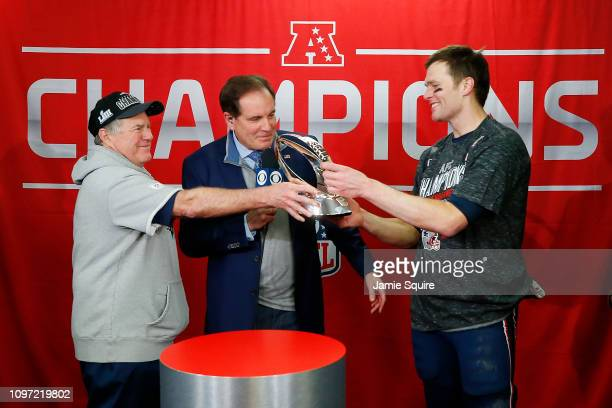 Head coach Bill Belichick of the New England Patriots hands the Lamar Hunt Trophy to Tom Brady after defeating the Kansas City Chiefs during the AFC...