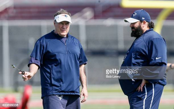 Head coach Bill Belichick of the New England Patriots left and defensive coordinator Matt Patricia talk during a practice session ahead of Super Bowl...