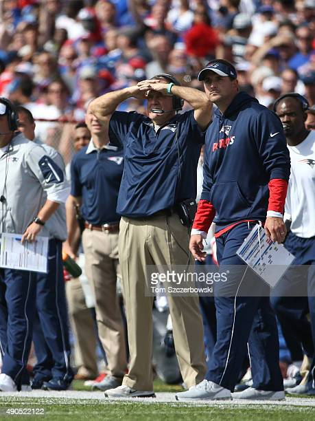 Head coach Bill Belichick of the New England Patriots looks on from the sideline beside special teams coach Joe Judge during NFL game action against...