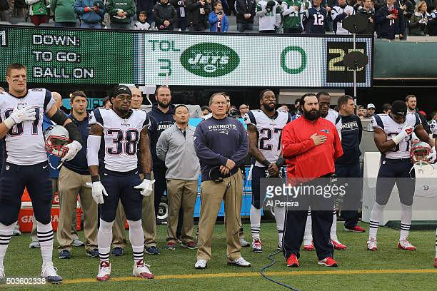 Head Coach Bill Belichick of the New England Patriots participates in the National Anthem before the game against the New York Jets at MetLife...