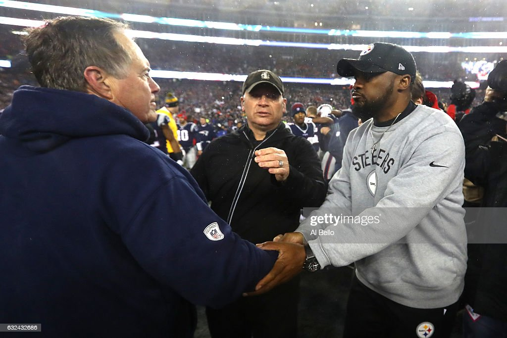 Head coach Bill Belichick of the New England Patriots (L) shakes hands with head coach Mike Tomlin of the Pittsburgh Steelers after the Patriots defeated the Steelers 36-17 to win the AFC Championship Game at Gillette Stadium on January 22, 2017 in Foxboro, Massachusetts.