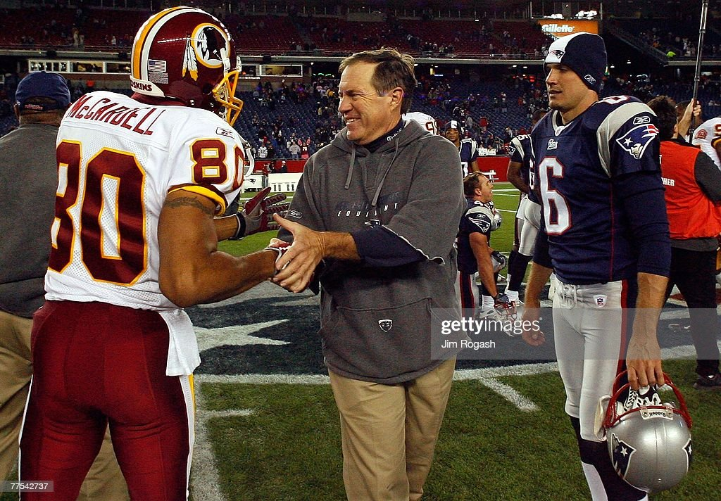 Head coach Bill Belichick of the New England Patriots shakes hands with Keenan McCardell #80 of the Washington Redskins as Matt Cassel of the Patriots stands by on October 28, 2007 at Gillette Stadium in Foxboro, Massachusetts. The Patriots defeated the Redskins 52-7.