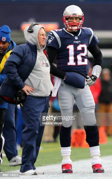 Head coach Bill Belichick of the New England Patriots stands with Tom Brady during the second half against the Buffalo Bills at Gillette Stadium on...