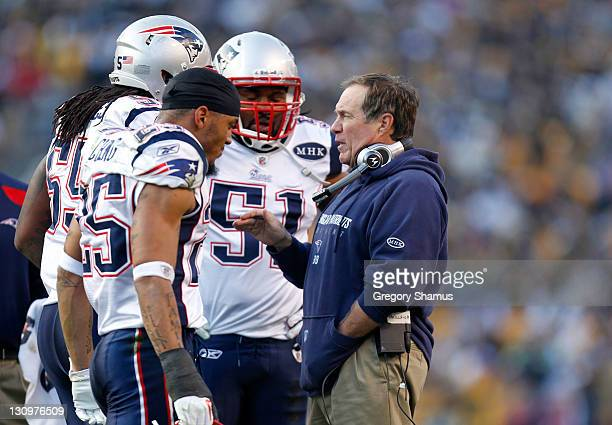 Head coach Bill Belichick of the New England Patriots talks to Jerod Mayo Patrick Chung and Brandon Spikes at Heinz Field on October 30 2011 in...