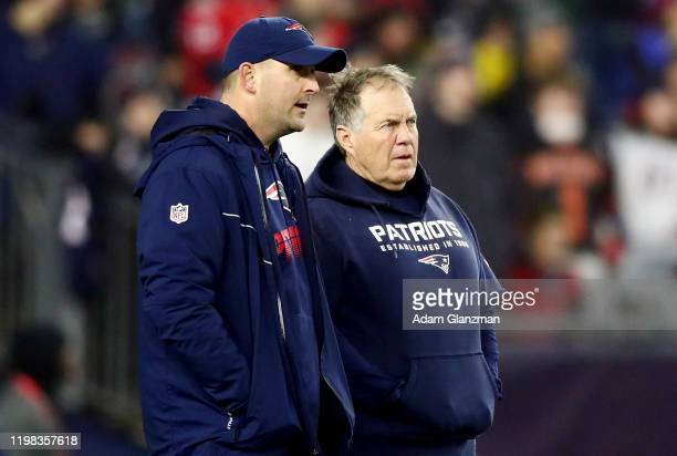 Head coach Bill Belichick of the New England Patriots talks with Special Teams Coordinator Joe Judge in the AFC Wild Card Playoff game against the...