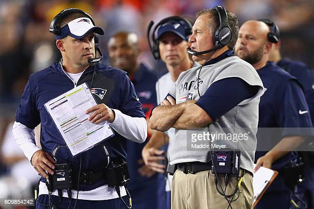 Head coach Bill Belichick of the New England Patriots talks with offensive coordinator Josh McDaniels during the first half against the Houston...