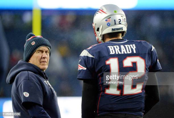 Head coach Bill Belichick of the New England Patriots talks with Tom Brady before the game against the Dallas Cowboys at Gillette Stadium on November...