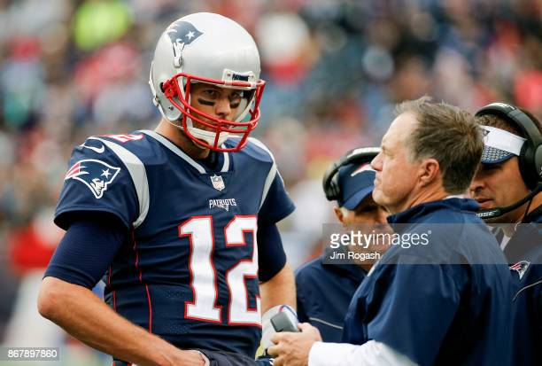 Head coach Bill Belichick of the New England Patriots talks with Tom Brady during the fourth quarter of a game against the Los Angeles Chargers at...