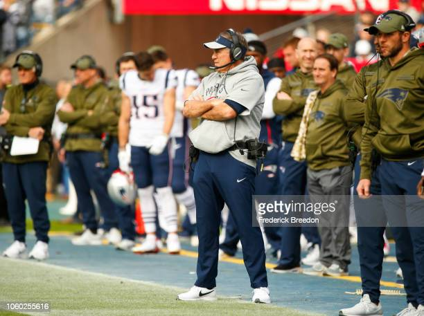 Head coach Bill Belichick of the New England Patriots watches his offense during the first quarter against the Tennessee Titans at Nissan Stadium on...