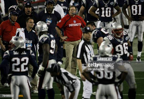 Head coach Bill Belichick of the New England Patriots watches his team from the sidelines in the second quarter against the New York Giants during...