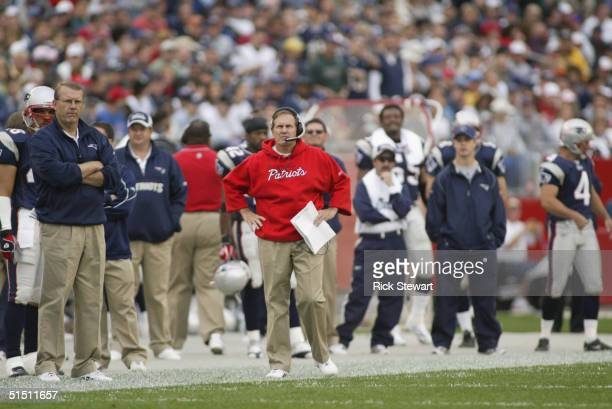Head coach Bill Belichick of the New England Patriots watches the game against the Miami Dolphins at Gillette Stadium on October 10, 2004 in Foxboro,...