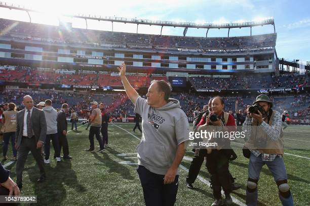 Head coach Bill Belichick of the New England Patriots waves after the New England Patriots defeated the Miami Dolphins 387 at Gillette Stadium on...