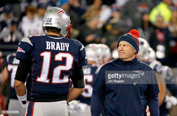Head coach Bill Belichick talks with Tom Brady of the New England Patriots before a game against the Seattle Seahawks at Gillette Stadium on November...