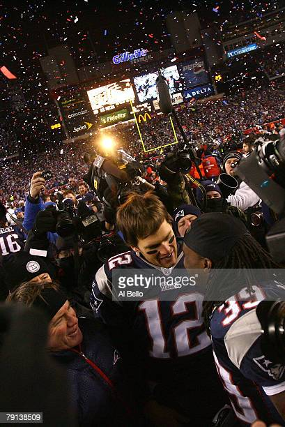 Head coach Bill Belichick Tom Brady and Laurence Maroney of the New England Patriots celebrate on the field after the Patriots 2112 win against the...