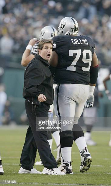 Head Coach Bill Callahan of the Oakland Raiders motivates his team as they leave the field during the AFC Championship game against the Tennessee...