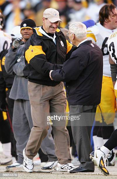 Head coach Bill Cowher of the Pittsburgh Steelers celebrates with team owner Dan Rooney moments before defeating the Denver Broncos in the AFC...