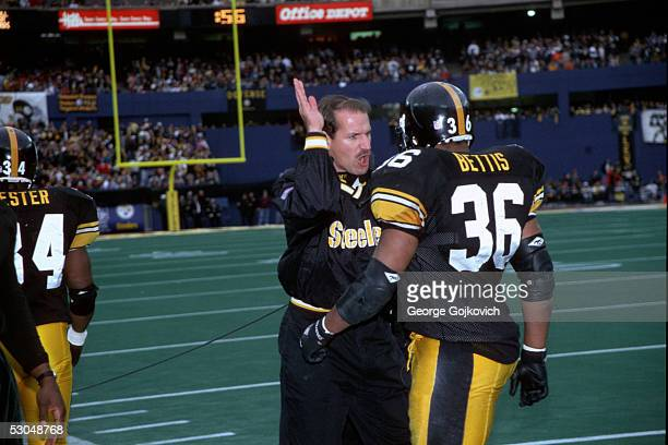 Head coach Bill Cowher of the Pittsburgh Steelers gestures while talking to running back Jerome Bettis during a game against the Jacksonville Jaguars...