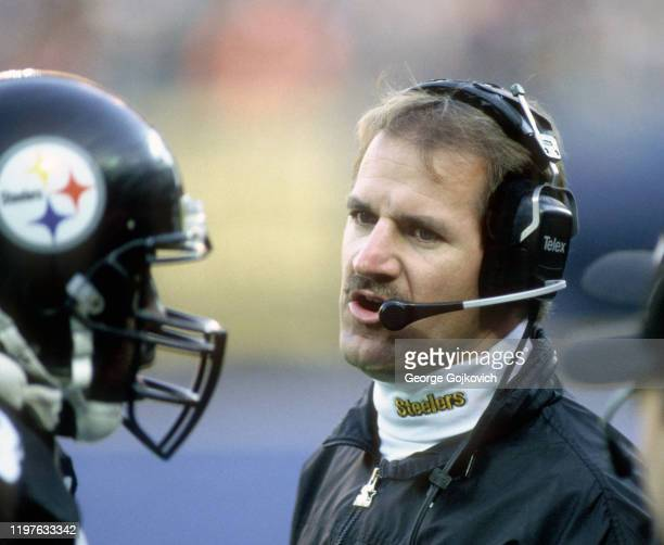 Head coach Bill Cowher of the Pittsburgh Steelers talks to a player on the sideline during a game against the San Diego Chargers at Three Rivers...