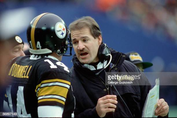 Head coach Bill Cowher of the Pittsburgh Steelers talks with quarterback Neil O'Donnell during a game against the Seattle Seahawks at Three Rivers...