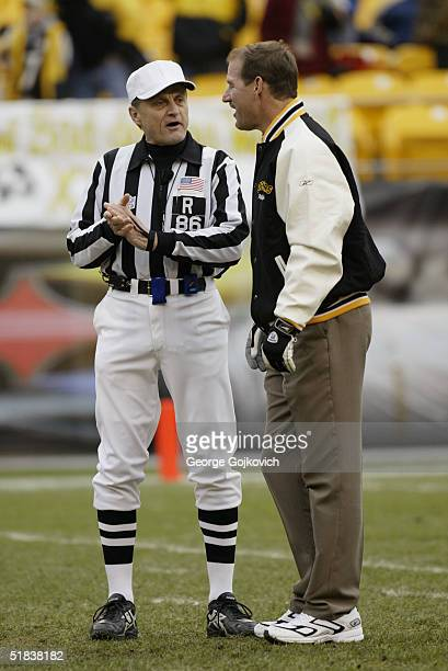 Head coach Bill Cowher of the Pittsburgh Steelers talks with referee Bernie Kukar prior to the start of a game against the Washington Redskins at...