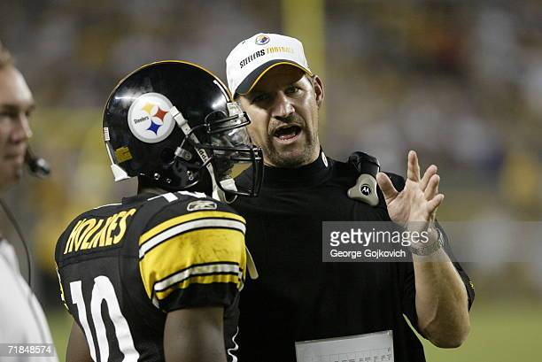 Head coach Bill Cowher of the Pittsburgh Steelers talks with wide receiver Santonio Holmes during a game against the Miami Dolphins at Heinz Field on...