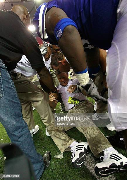 Head coach Bill Curry of the Georgia State Panthers is helped up off the field after getting hit in the head by a water cooler in the final minutes...