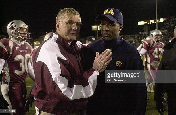 Head Coach Bill Doba of the Washington State University Cougars meets with Head Coach Karl Dorrell of the UCLA Bruins after the Cougars beat the...