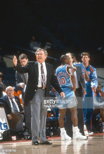 Head coach Bill Fitch of the New Jersey Nets looks on against the Washington Bullets during an NBA basketball game circa 1991 at the Capital Centre...