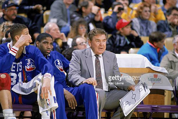 Head Coach Bill Fitch of the New Jersey Nets sits on the bench with teammates during the NBA game against the Los Angeles Lakers at the Great Western...