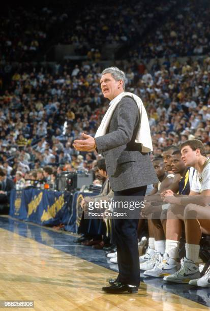 Head coach Bill Frieder of the University of Michigan looks on during an NCAA College basketball game circa 1988 at Crisler Arena in Ann Arbor...