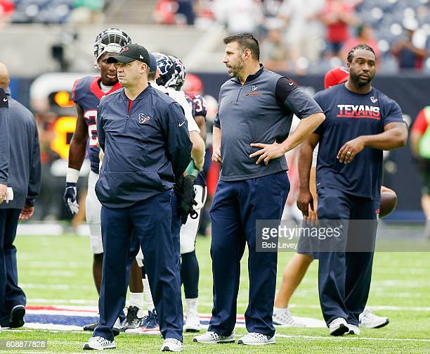 Head coach Bill O'Brien looks over the team in warmups before playing the Kansas City Chiefs at NRG Stadium on September 18 2016 in Houston Texas
