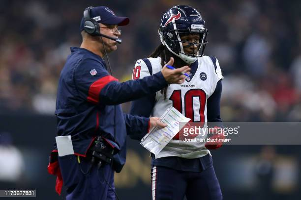 Head coach Bill O'Brien of the Houston Texans and DeAndre Hopkins talk during a game against the New Orleans Saints at the Mercedes Benz Superdome on...