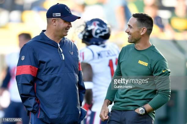 Head coach Bill O'Brien of the Houston Texans and head coach Matt LaFleur of the Green Bay Packers meet before a preseason game at Lambeau Field on...