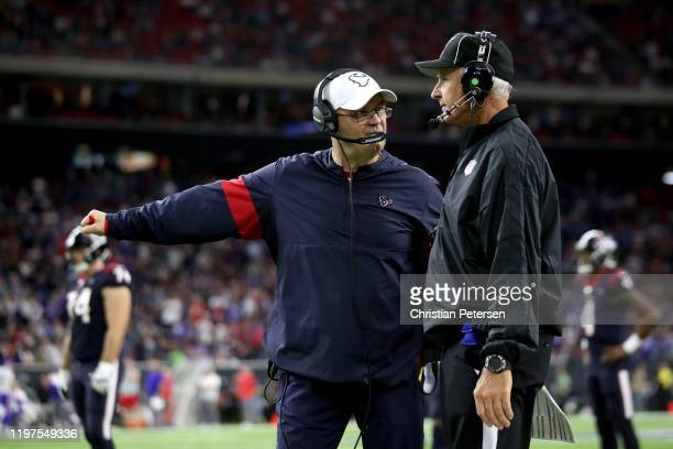 Head coach Bill O'Brien of the Houston Texans argues the call on the opening kickoff of the second half against the Buffalo Bills during the third...