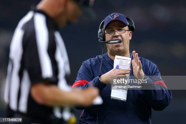 Head coach Bill O'Brien of the Houston Texans calls a timeout during the first half of a game against the New Orleans Saints at the Mercedes Benz...