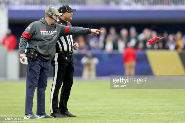 head coach Bill O'Brien of the Houston Texans challenges a play against the Baltimore Ravens during the first quarter in the game at MT Bank Stadium...