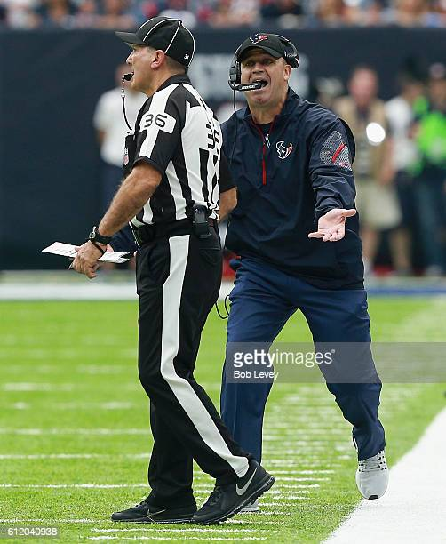 Head coach Bill O'Brien of the Houston Texans has words with line judge Tony Veteri after the play clock expired late in the second quarter...