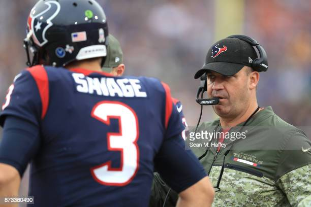 Head Coach Bill O'Brien of the Houston Texans is talks to quarterback Tom Savage during the game against the Los Angeles Rams at the Los Angeles...