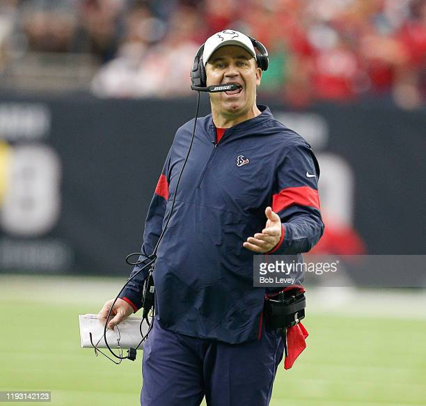 Head coach Bill O'Brien of the Houston Texans questions a penalty call by the officials during the second half against the Denver Broncos at NRG...