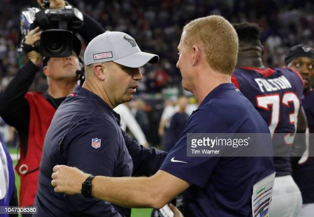 Head coach Bill O'Brien of the Houston Texans shakes hands with head coach Jason Garrett of the Dallas Cowboys after overtime win by the Texans at...