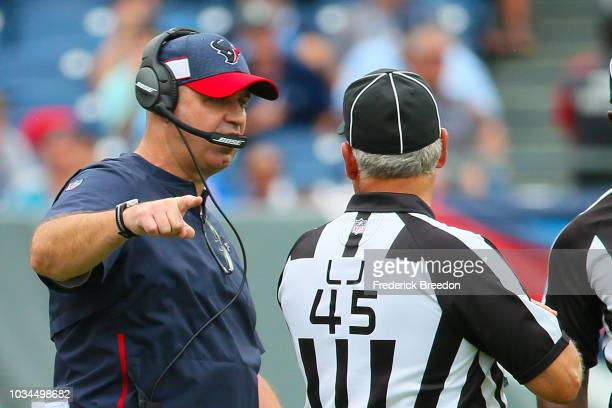 Head coach Bill O'Brien of the Houston Texans speaks to an official during the second half of a game against the Tennessee Titans at Nissan Stadium...