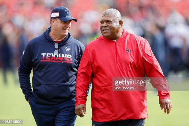 Head coach Bill O'Brien of the Houston Texans talks to assistant head coach and defensive coordinator Romeo Crennel before the game against the...