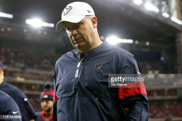 Head coach Bill O'Brien of the Houston Texans walks off the field after the second quarter against the Buffalo Bills of the AFC Wild Card Playoff...