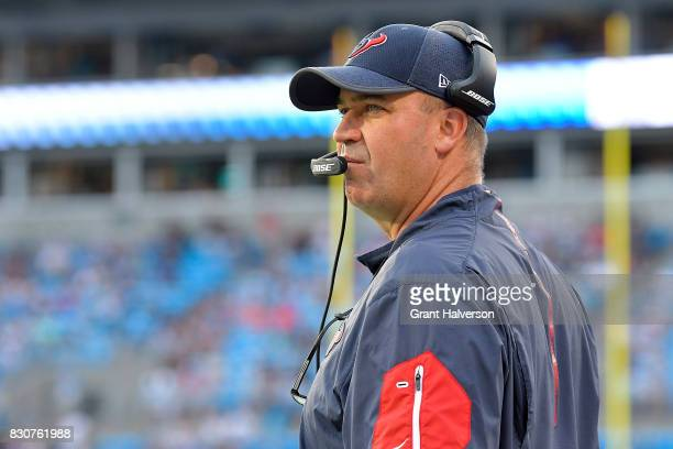 Head coach Bill O'Brien of the Houston Texans watches his team during their game against the Carolina Panthers at Bank of America Stadium on August 9...